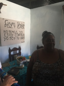"""Sister Mireles and her husband lead out in one of the """"small groups"""" in her house. This is where people come together and talk more about the Bible."""